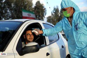 عکس/ اجرای طرح تب سنجی در عوارضی اتوبان قم _ تهران