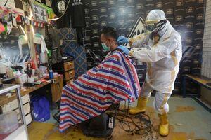 عکس/ لباس محافظت شده یک آرایشگر