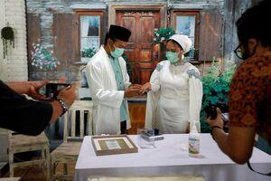 عکس/ برگزاری عروسی زیرسایه کرونا
