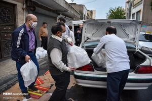 عکس/ توزیع بستههای سبد کالا در جنوب تهران