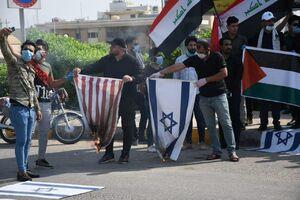 عکس/ آتش زدن پرچم اسرائیل و آمریکا در عراق