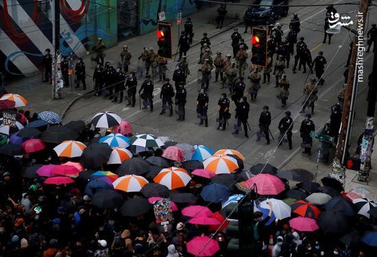 عکس/ راهکار مردم آمریکا برای درامان ماندن از پلیس