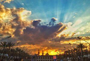 عکس/ طلوع زیبای خورشید در کربلا