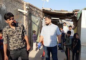 کمکرسانی قهرمان کشتی در مناطق محروم تهران +عکس
