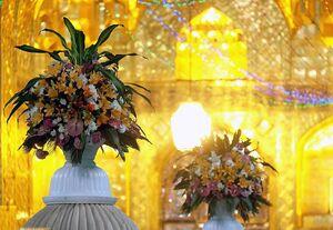 بستهای متبرک از گل آراییهای آستان قدس +عکس