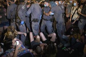 عکس/ درگیری پلیس و معترضان به فسادهای نتانیاهو