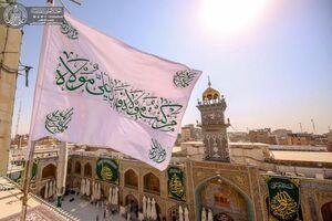 عکس/ پرچم حرم حضرت علی(ع) تعویض شد