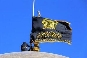 تعویض پرچم گنبد و پوش ضریح حرم رضوی