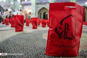 عکس/ توزیع بسته نذری و ارزاق در شیراز