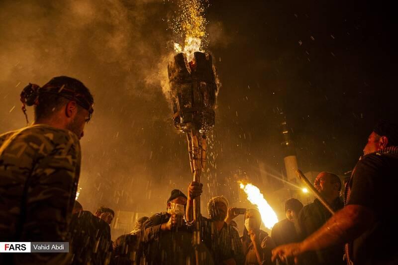 مشعل اصلی که تا زمان خاموشی آن مراسم به طول می کشد-آئین مذهبی پولکه پرانی