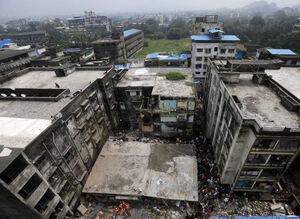 عکس/ ریزش مرگبار یک ساختمان در هند