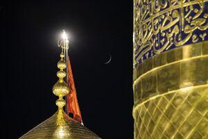 تعویض پرچم حرم امام حسین(ع)