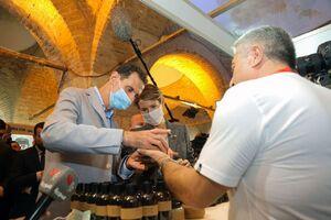 عکس/ بشار اسد و همسرش در نمایشگاه دمشق