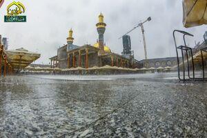 عکس/ حال و هوای بارانی حرمین کاظمین