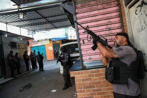 عکس/ تیراندازی مرگبار میان پلیس برزیل با قاچاقچیان
