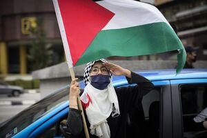 عکس/ خوشحالی مردم مالزی از پیروزی مقاومت فلسطین