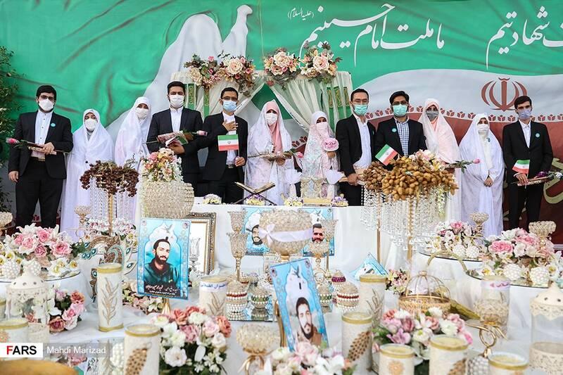 عکس یادگاری زوجهای جهادگر پای سفره عقد