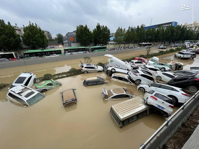 عکس/ خسارات سیل به خودروها در چین