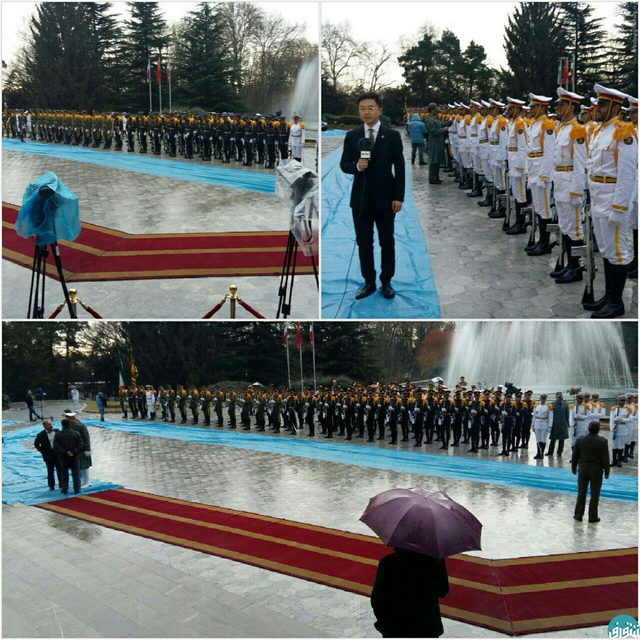 عکس/ دردسر هوای بارانی در استقبال از رئیس جمهور چین