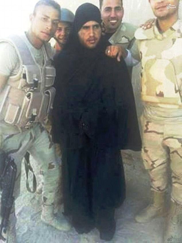 1548759 153 عکس/ بازداشت یک داعشی با لباس مخصوص زنان و دختران جوان