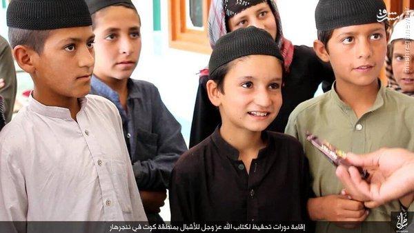 بیعت صدها نفر از اعضای طالبان با داعش+عکس
