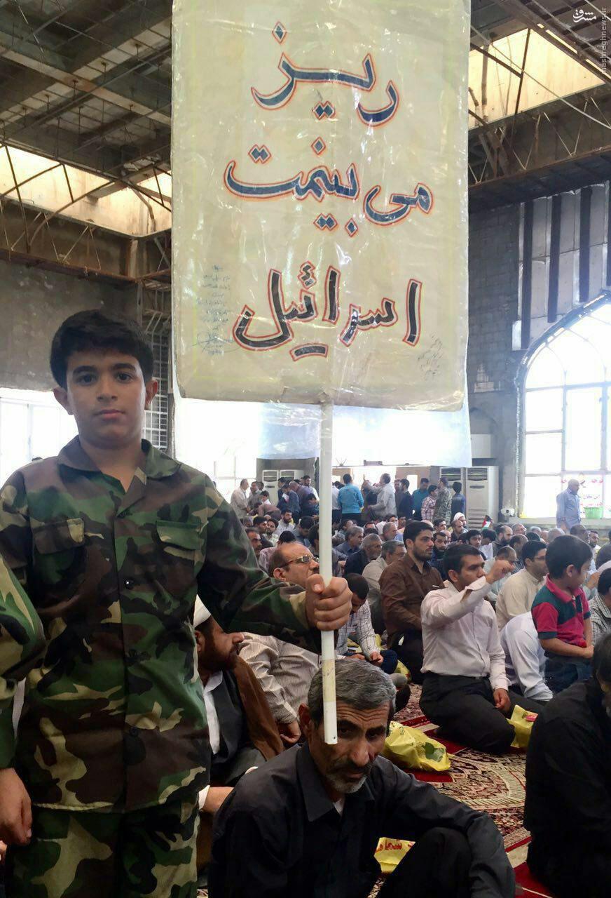 عکس/ شعار جالب یک نوجوان ایرانی در راهپیمایی روز قدس