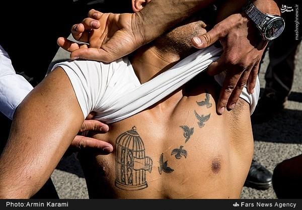 عکس/ خالکوبی عجیب روی سینه یک سارق