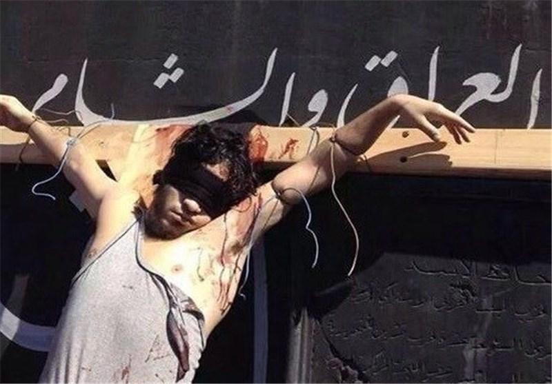 به صلیب کشیدن یک سوری توسط داعش+عکس