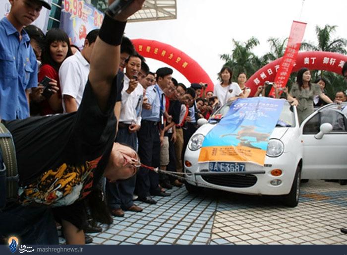عکس/ زورآزمایی عجیب مرد چینی