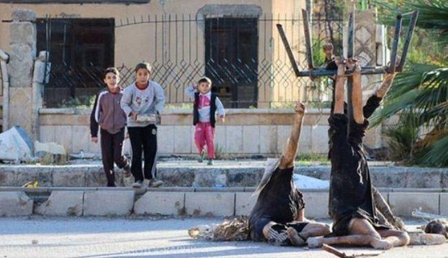 اجساد قربانیان داعش در برابر کودکان+عکس
