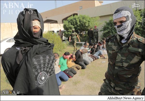 عکس/ بازداشت عضو داعش با لباس زنانه