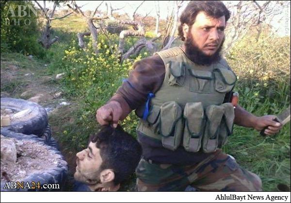 تروریست آدمخوار با سر بریده در ادلب حاضر شد + عکس