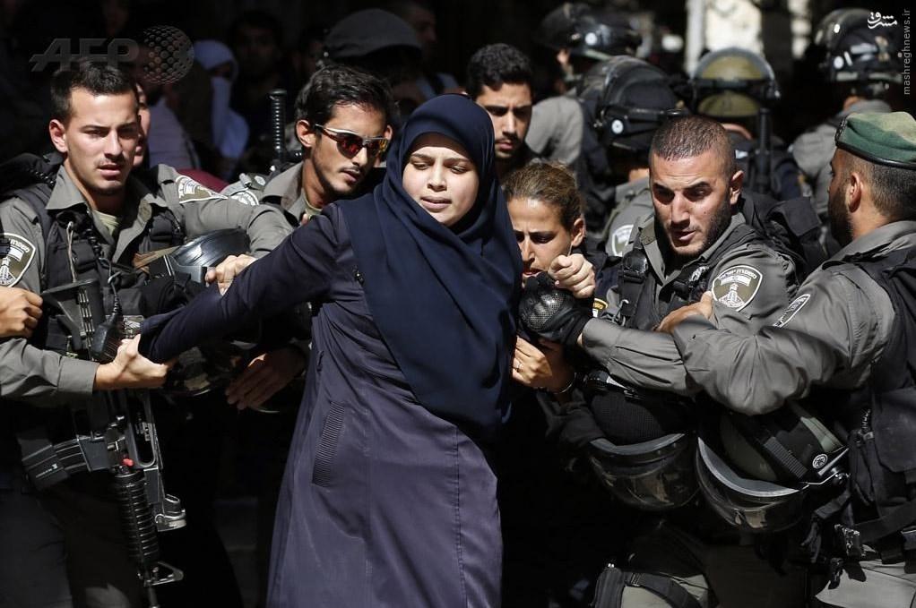 زن فلسطینی اسیرچنگالهای 5نظامی اسرائیلی+عکس
