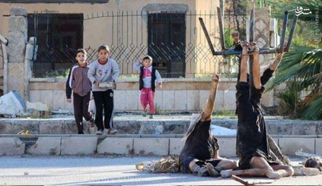 داعش 18 عراقی را مثله و از تیرچراغ برق آویزان کرد