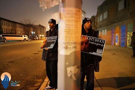 شب زنده داری اعتراض آمیز به خاطر کشته شدن نوجوان16ساله به ضرب گلوله،آمریکا