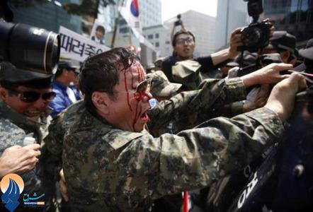درگیری پلیس سئول با معترضان ضددولت ژاپن در مقابل سفارت ژاپن در سئول _ کرهجنوبی