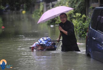 جاری شدن سیل در شهر تونگ ژیانگ چین