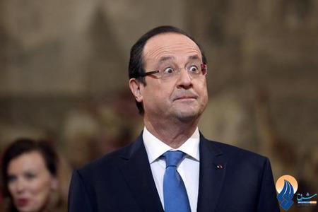 رئیس جمهور فرانسه در هنگام گرفتن یک مدال شجاعت در کاخ الیزه