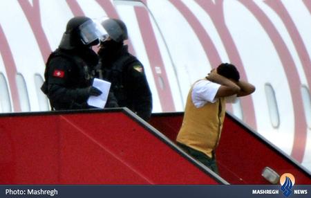 دستگیری کمک خلبان هواپیمای اتیوپیایی که بعد از اینکه هواپیما در فرودگاه ژنو به زمین نشست اعلام کرد که وی اقدام به ربودن هواپیما کرده است.