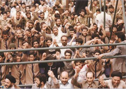 شهید سید اسدالله لاجوردی به اتفاق زندانیان تواب در نماز جمعه تهران