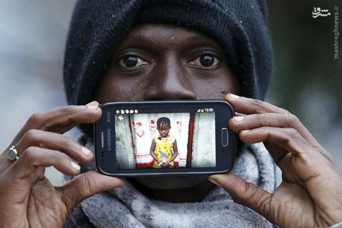 مهاجر اهل کنگو و تصویر دخترش