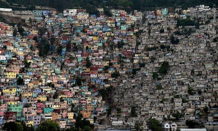 رنگ آمیزی خانه های کوهپایه ای در پایتخت هائیتی