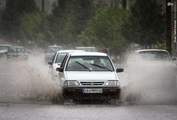 بارش باران و جاری شدن سیلاب در قم