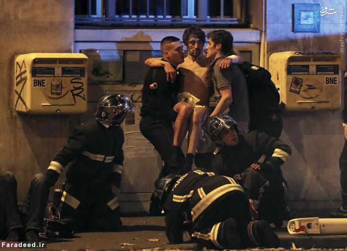 امدادگران در حال کمک به قربانیان حملات تروریستی در پاریس. 13 نوامبر 2015